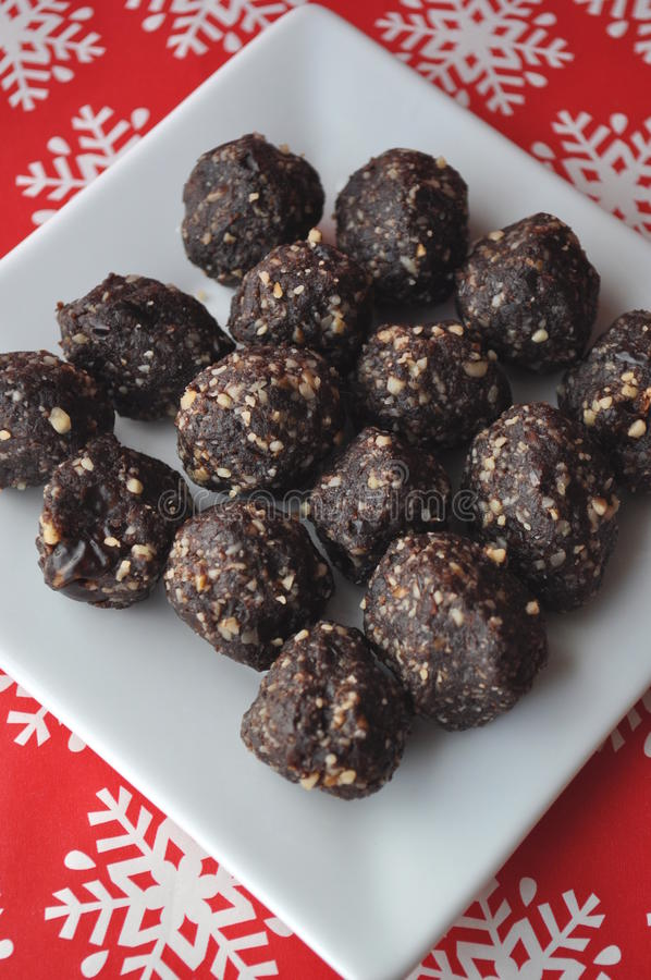 Download Raw Walnut, Chocolate And Date Balls On A White Plate And Winter Background With Snowflakes Stock Image - Image: 83724425
