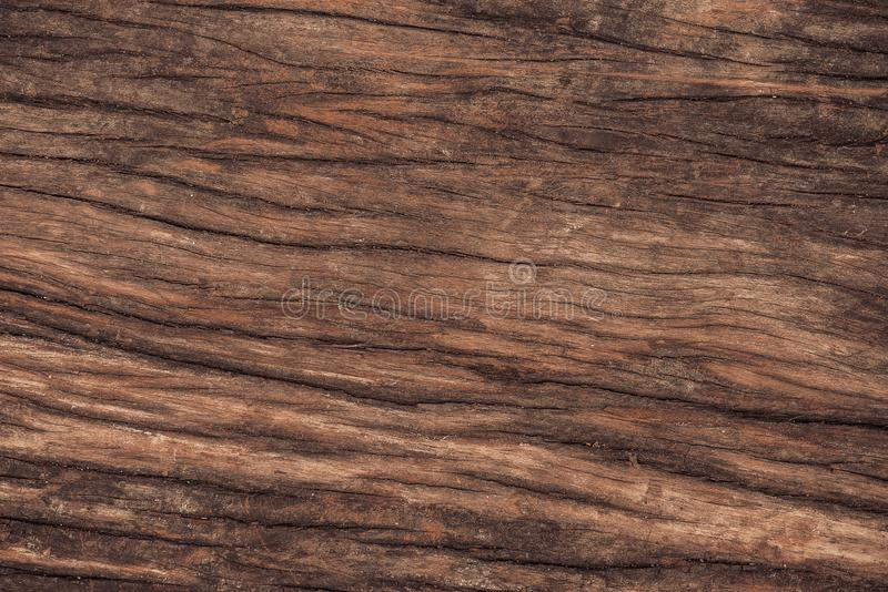 Raw wood, wooden slatted fence or lath wall background. Raw wood, wooden slatted fence or lath wall background texture in vintage tone with vignetting royalty free stock photo