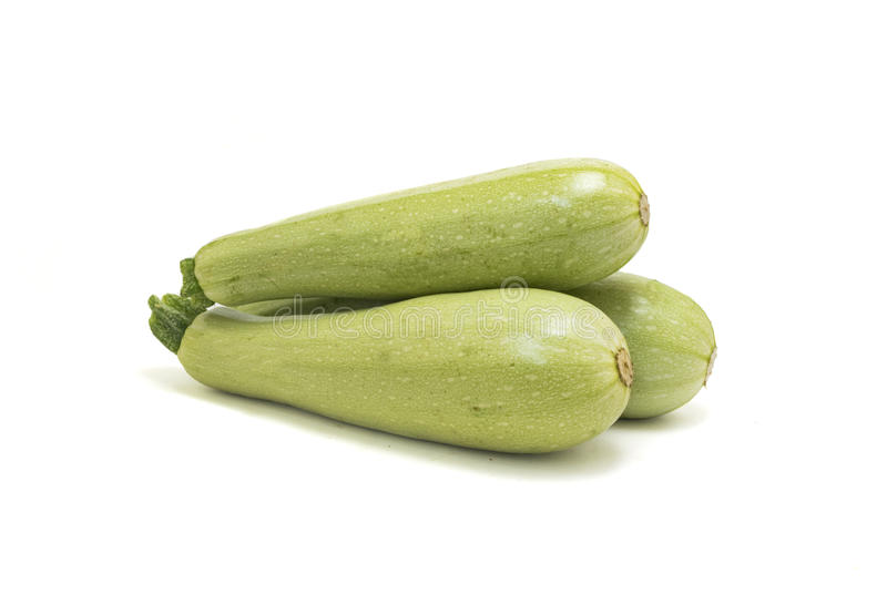 Raw zucchini isolated on white royalty free stock photo