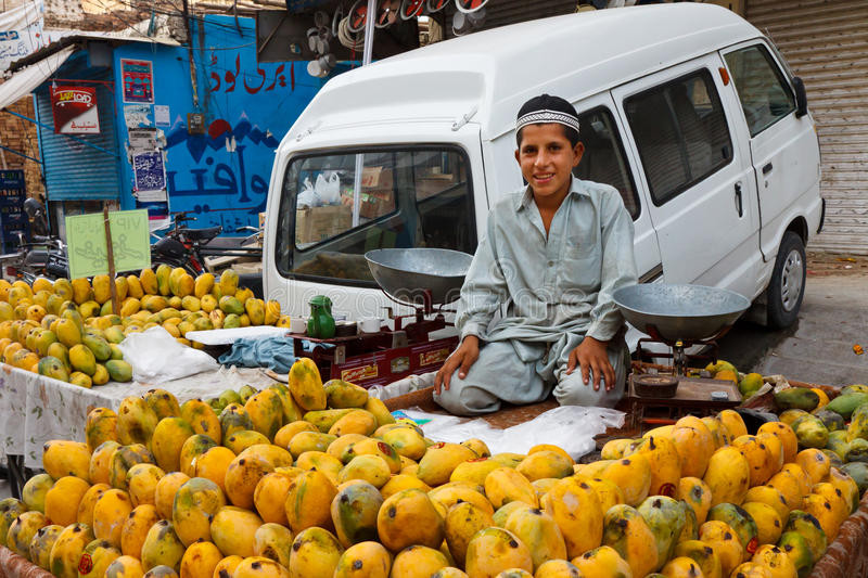 Raja Bazaar in Rawalpindi, Pakistan. RAWALPINDI, PAKISTAN - JULY 16: Unidentified Pakistani boy sells fruits at Raja Bazaar on July 16, 2011 in Rawalpindi stock photo