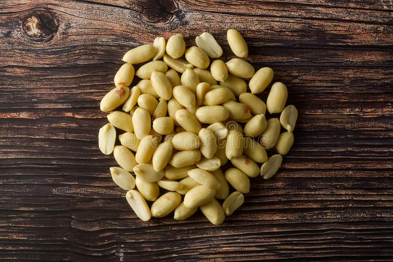 Raws peanut on wooden table, top view stock images