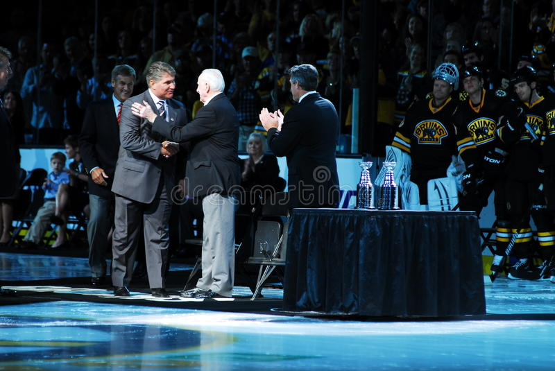 Ray Bourque greets Milt Schmidt stock photography