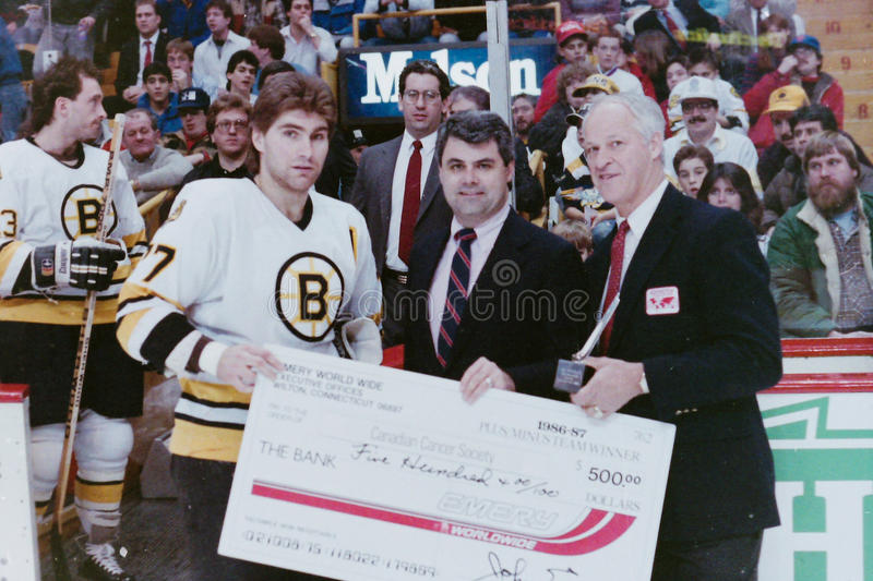 Ray Bourque presented a check from Gordie Howe. royalty free stock photography