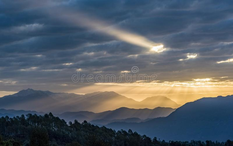 Ray of God. A view of hills with rays of sun and clouds over it. I took this photo fron Berinag, Uttarakhand royalty free stock image
