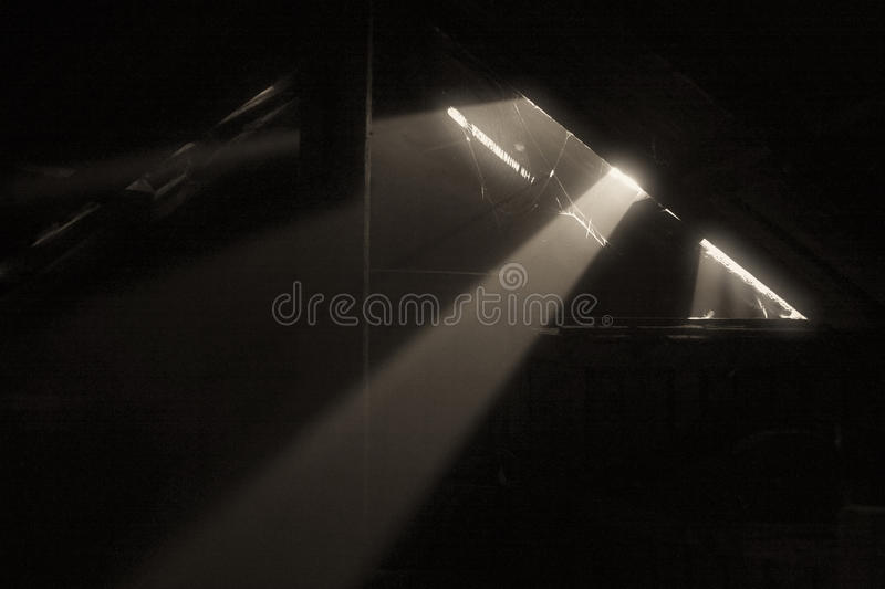 Ray of light. In an attic stock photos