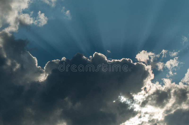 ray of light in cloudy sky stock photos