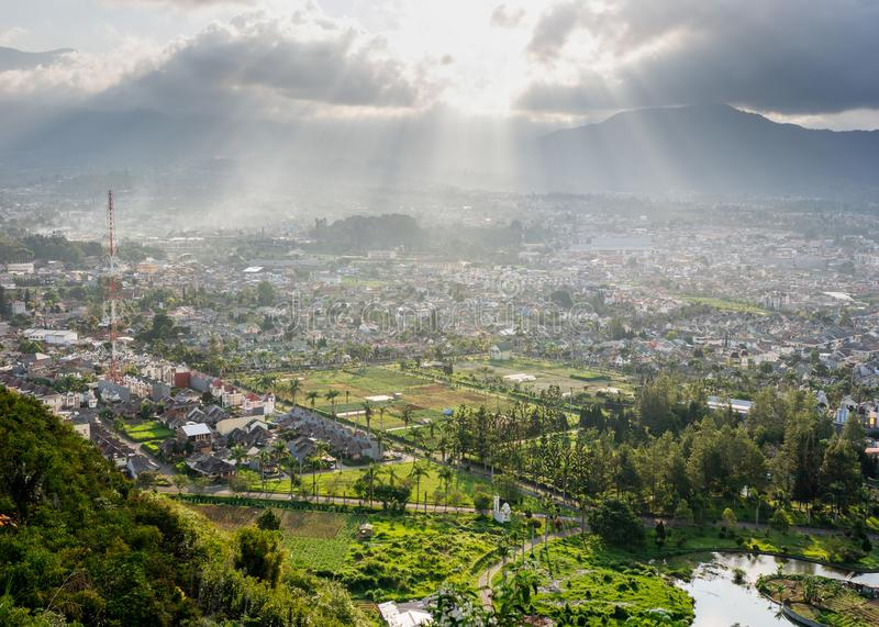 Ray of light shining over the city royalty free stock photography