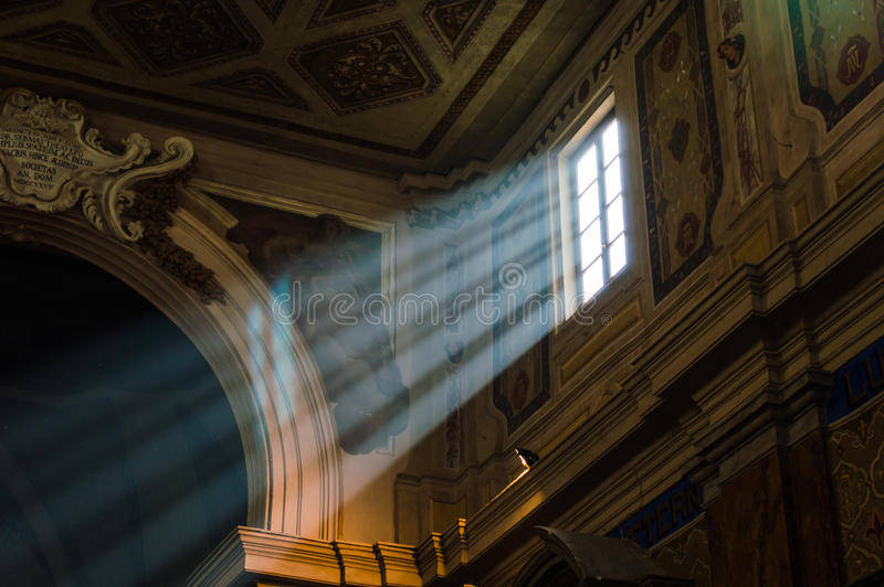 Ray of light. In a window in ancient italian church stock images