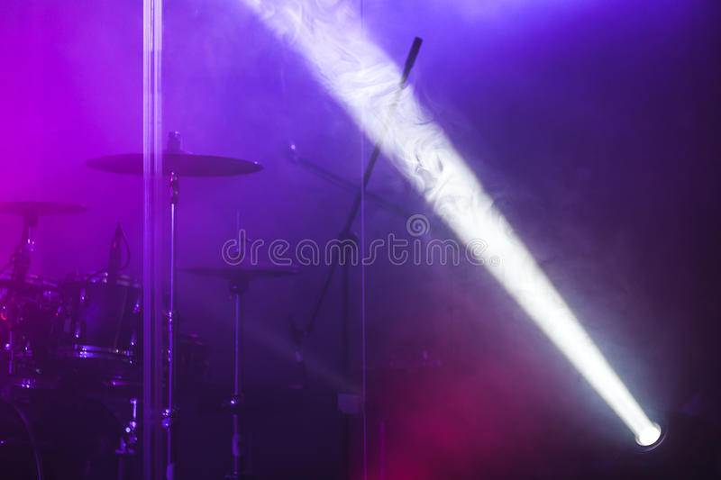 Ray of scenic spot light. Over blurred csenic background, stage illumination equipment stock image