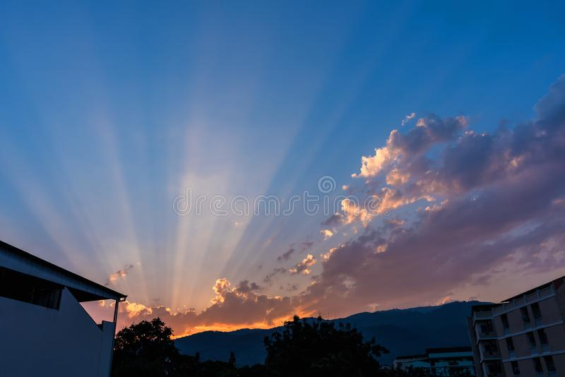 Ray on the sky on day time. Image of building and mountain with sun Crepuscular ray& x28;beam& x29; on sky in background. Air, atmosphere, beautiful, beauty stock photos