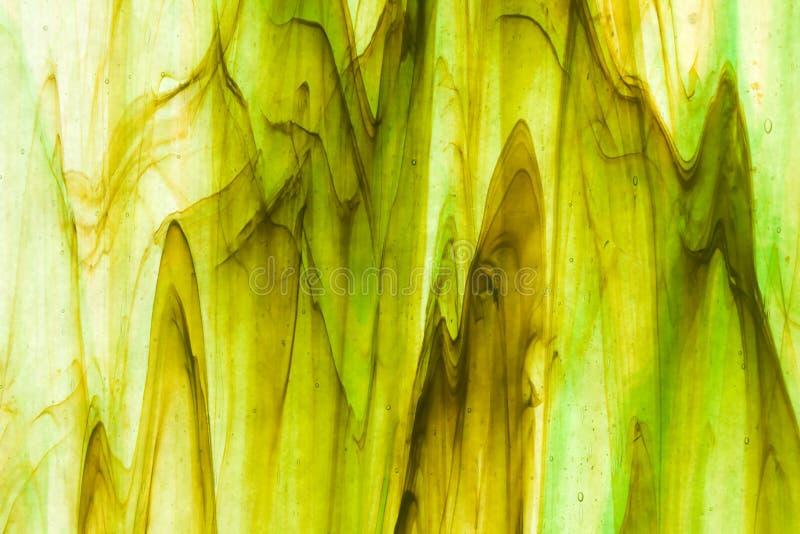 Rayado verde y marrón del vidrio manchado imagen de archivo