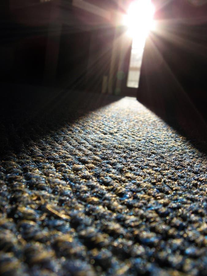 Rayo de la luz del sol en la alfombra imagenes de archivo