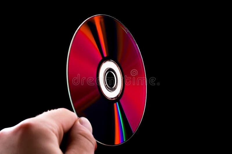 rayon cd bleu abstrait de main de dvd de disque images libres de droits