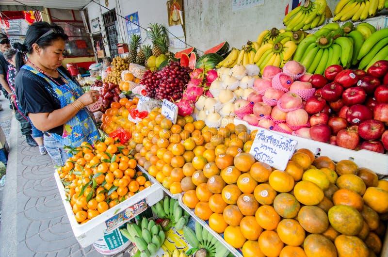 Rayong Sattahip, Thailand : Market women selling fruits. stock images