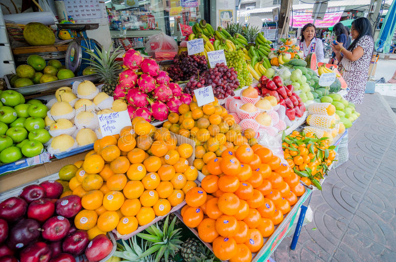 Rayong Sattahip, Thailand : Market women selling fruits. royalty free stock images