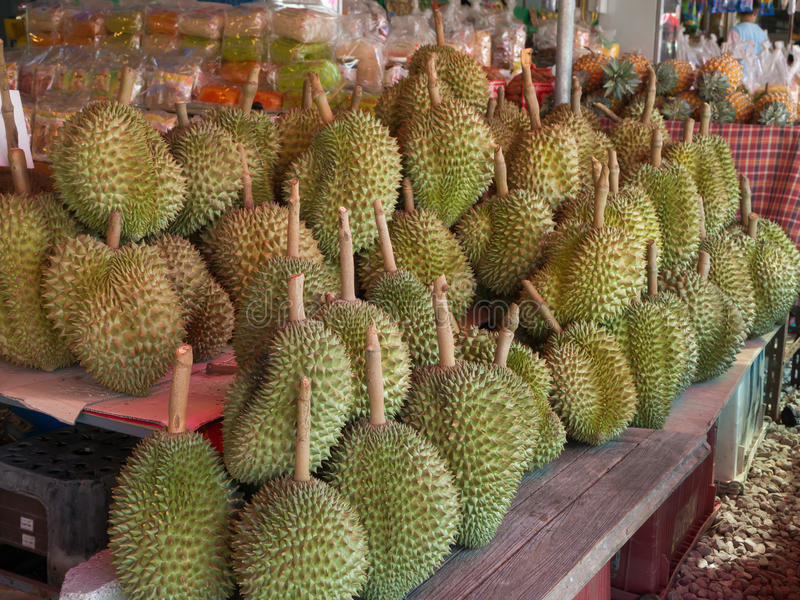 RAYONG, THAILAND-APRIL, 2017 : Group of ripe Durian on wood Shelf at fruit market shop, Rayong, Thailand. stock images