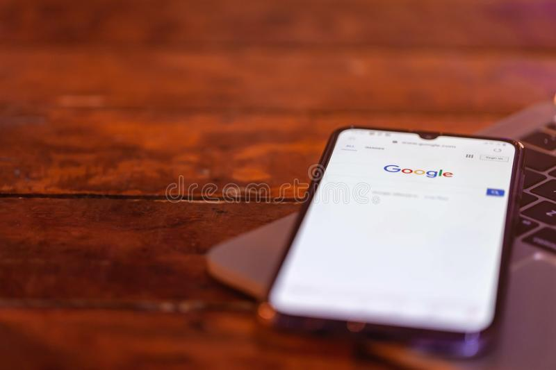 Rayong, Thailand, May 19, 2019: Google logo on smartphone screen placed on the laptop stock images