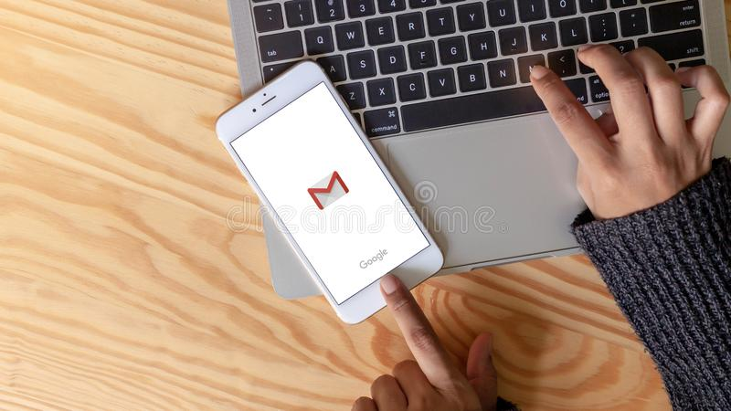 Rayong, THAILAND, May  20, 2019 : A woman hand holding gmail app logo Social networks icons showing on Apple iPhone 6 plus stock photo