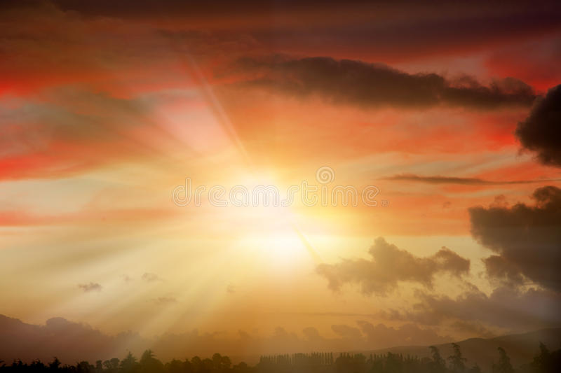 Rays of light. Bright rays of sunlight beam out in dramatic sky stock photo