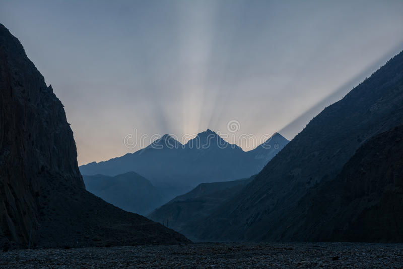 Rays of light above Annapurna range peaks in the morning sun royalty free stock photography