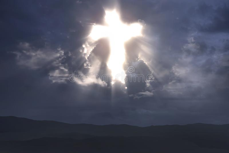 Rays of light from Christian cross stock photo