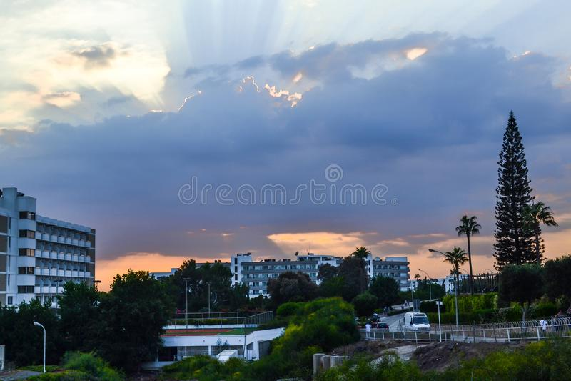 The rays of sunlight make their way through the clouds over Ayia Napa. Cyprus.  stock photography