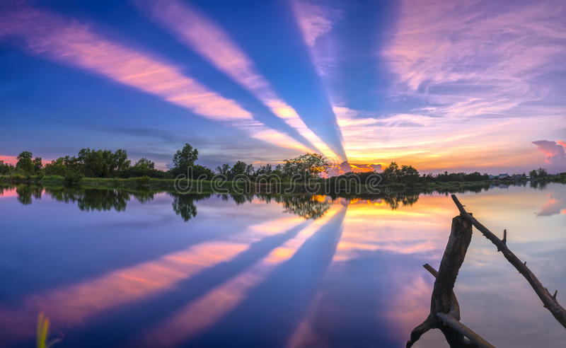 Rays of sunset along river when the sun goes down royalty free stock photo