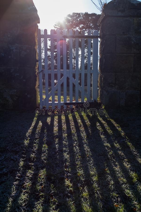 Rays of sunshine entering through a gate royalty free stock photo