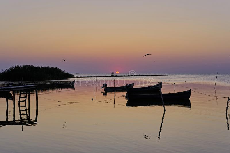 A small fishermen`s harbor. On the Razelm Lake, near the Danube Delta, Sarichioi is a small fishermen`s harbour very beautifull in the morning light. Old boats royalty free stock image