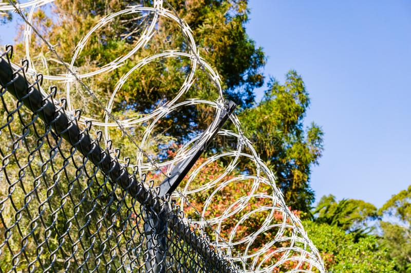 Razor barbed wire security fence, California stock photography