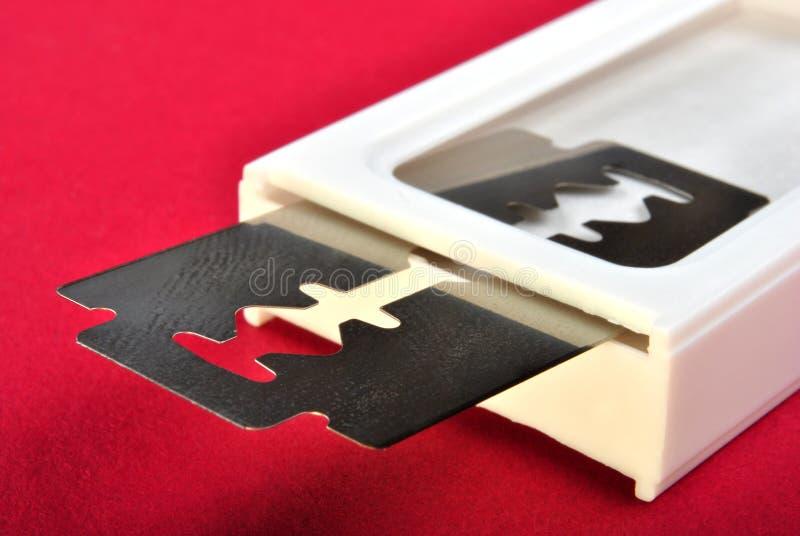 razor blade and a white pvc box royalty free stock image