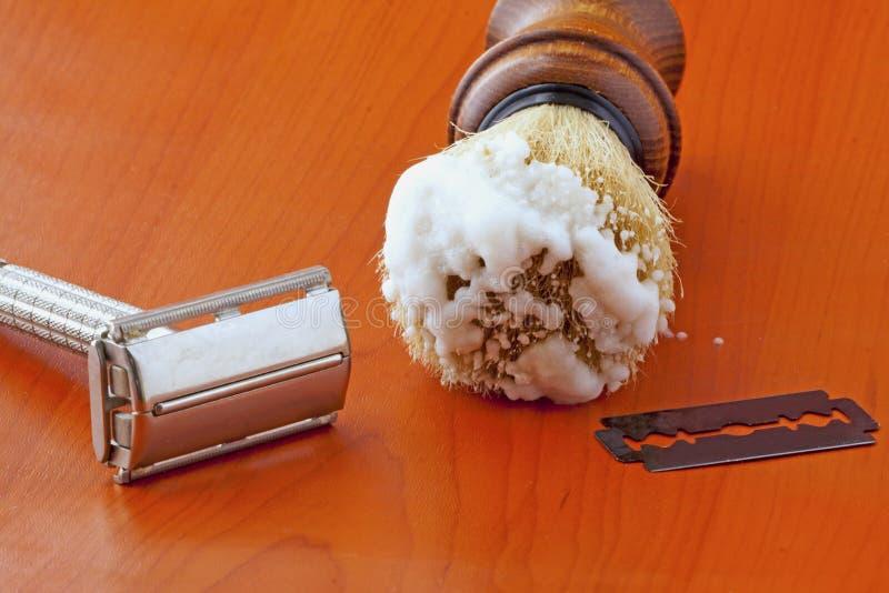 Razor and brush. An old razor near shaving brush stock images