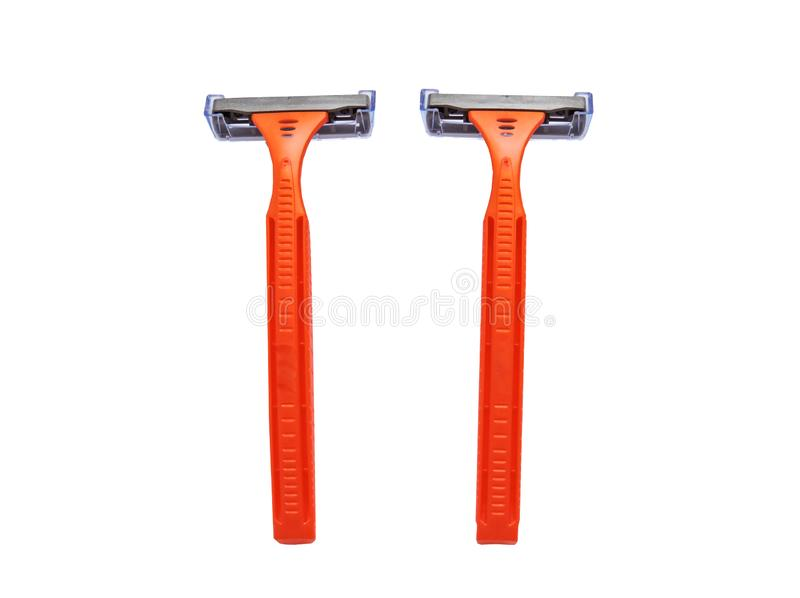 Razor in a female hand on a white background. Removal of unwanted hair. top view. Concept of using razor. Orange men`s razors. Removal of unwanted hair. top view royalty free stock image