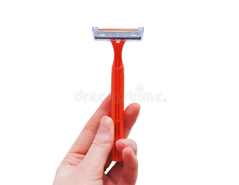 Razor in a female hand on a white background. Removal of unwanted hair. top view. Concept of using razor. Orange men`s razors. Removal of unwanted hair. top view stock images