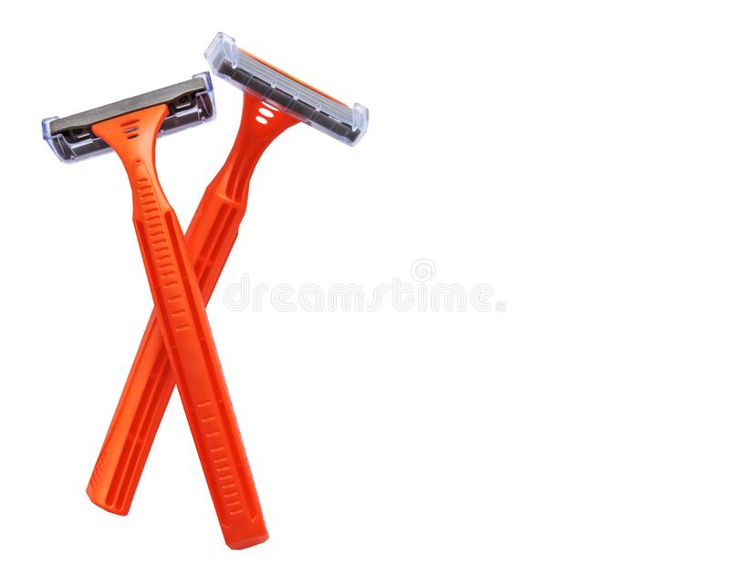 Razor in a female hand on a white background. Removal of unwanted hair. top view. Concept of using razor. Orange men`s razors. Removal of unwanted hair. top view royalty free stock images
