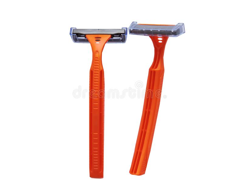 Razor in a female hand on a white background. Removal of unwanted hair. top view. Concept of using razor. Orange men`s razors. Removal of unwanted hair. top view stock photos