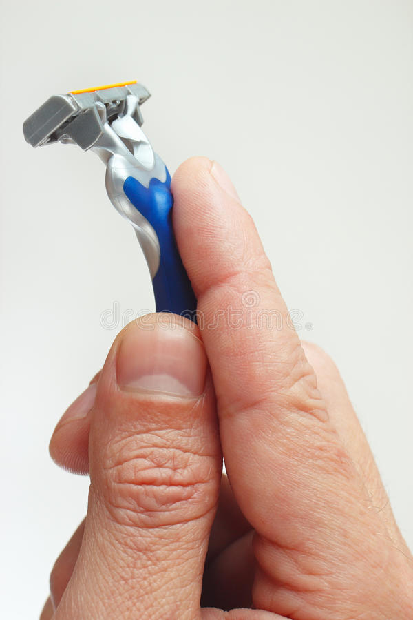 Razor in the hands of man closeup royalty free stock image