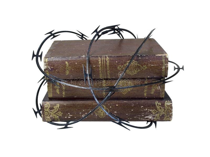 Razor Wire around old Books royalty free stock photography