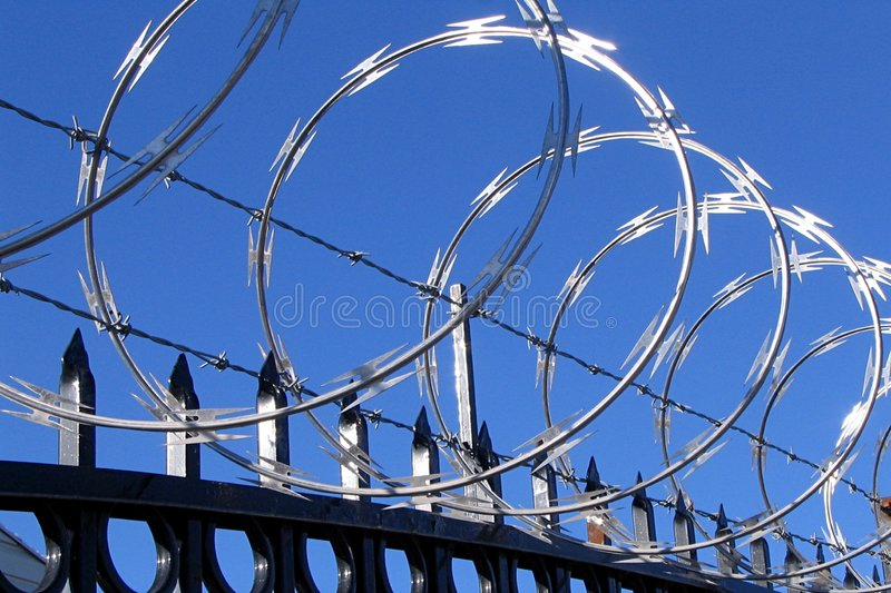 Razor wire and barbed wire royalty free stock photos