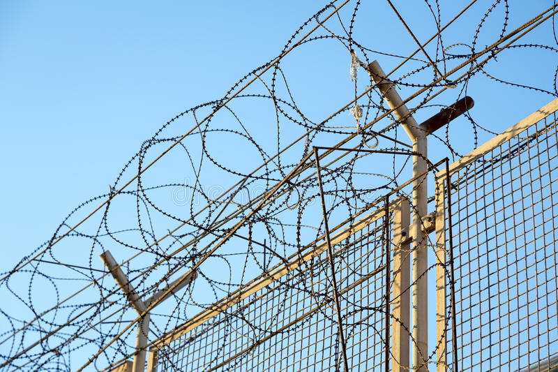 Razor Wire Barbed Wire Top Of Security Fence Stock Image - Image of ...