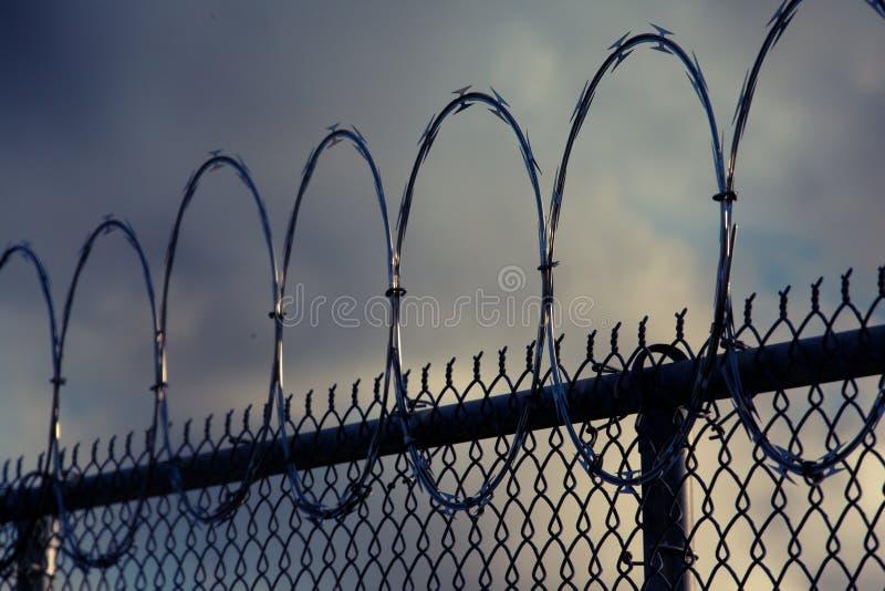 Razor wire on a prison fence. Spoiled razor wire on a prison fence stock image