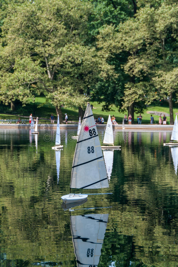 RC boats in the lake. Lake filled with RC boats driving royalty free stock photography