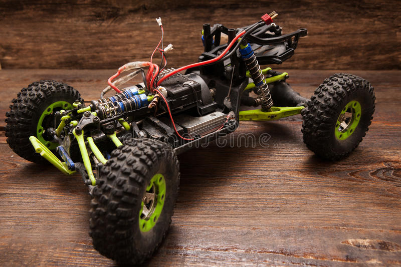 Rc car model toy on wooden background. Rc radio control car model on wooden background. Green toy suv on table, free space stock photography