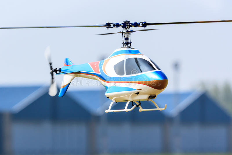 RC helicopter. Hovering remote control helicopter royalty free stock photography