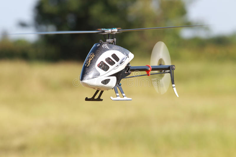Rc helicopter toy hovering in the field.  stock photo