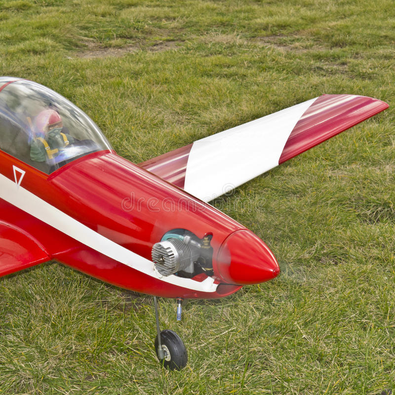 RC Model Aircraft bright red with white trim. Radio Control Model Aircraft bright red with white trim, close up, focussed on aircraft front and engine, with royalty free stock photo