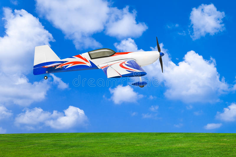 RC plane. On cloudy sky background royalty free stock photo