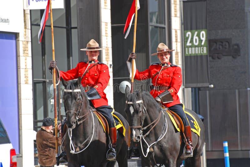 RCMP骑马在圣帕特里克` s天游行,渥太华,加拿大 免版税图库摄影