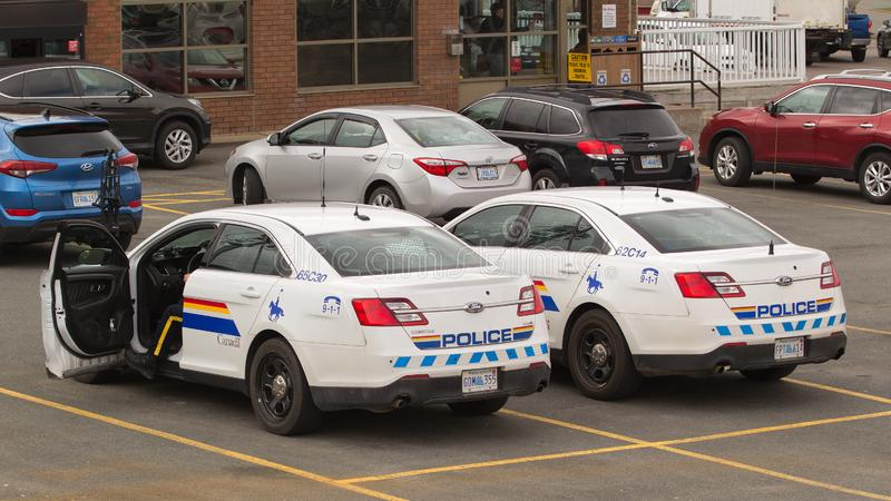RCMP Cruisers. Stewiacke, Canada - May 09, 2019: Royal Canadian Mounted Police or RCMP cruisers in parking lot. The RCMP is Canada`s federal and national police royalty free stock photos