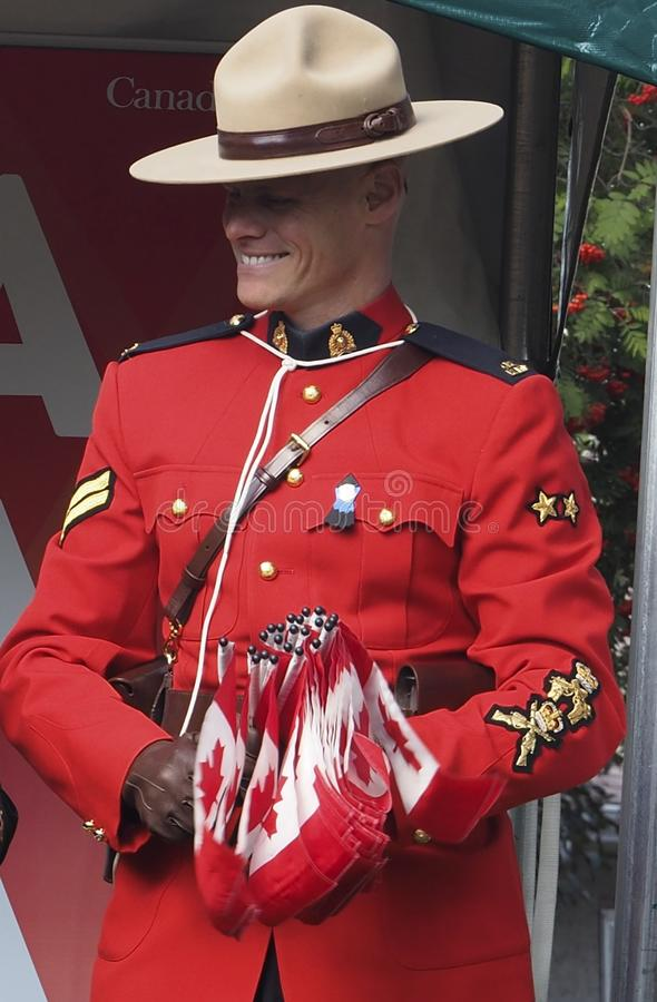 RCMP Officer With Canada Flags stock photo